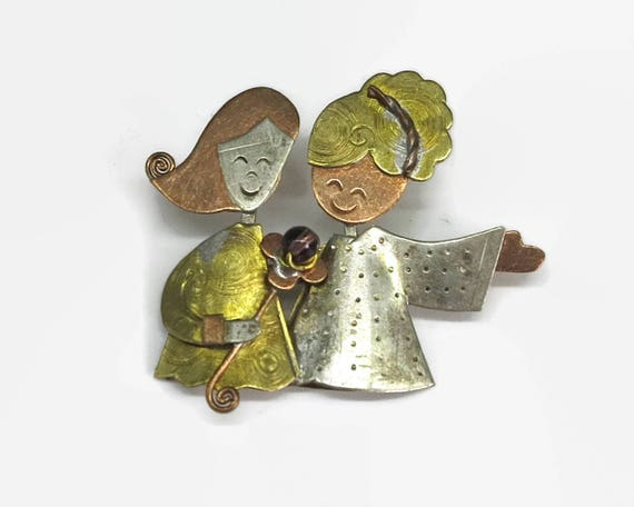 Vintage brooch / pendant with 2 young girls holding a flower, shades of silver, gold, copper, beaten metal, c-clasp, circa 1960s