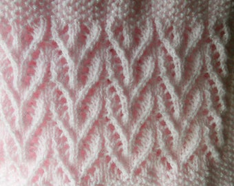 New hand knitted pink baby blanket