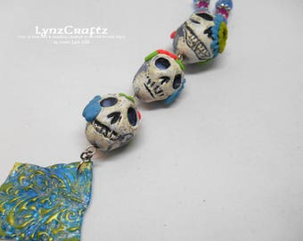 A Trio of Sugar Skulls white black blue & pink polymer clay pendant necklace jewelry charm handmade