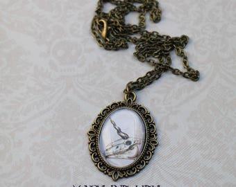 Unicorn skull cabochon necklace