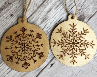 2 wooden baubles snowflakes pyrography woodburned stars rustic christmas decorations