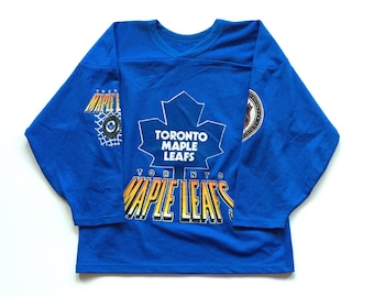 Deadstock Vintage Toronto Maple Leafs CCM All Over Print NHL Hockey Jersey Size Men's Medium, NOS Deadstock 90's