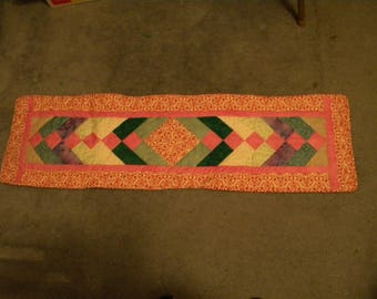 Green and Red-themed tablerunner
