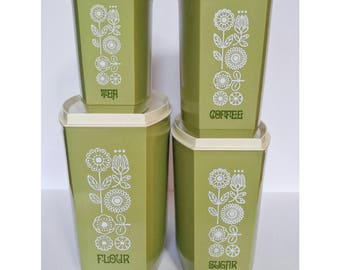 Retro green and white flowered canister set.