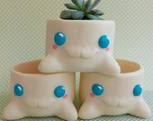 Flowerpot monster - cactus, succulents, and other plants - modeled by hand and created with a mold and resin