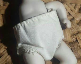 Vintage porcelain doll for parts, missing one arm.