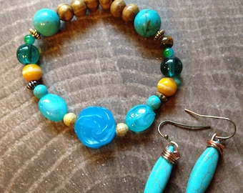 Carved Turquoise Rose bead with wood and glass beads in stretch cord, also cones with turquoise drip earrings wrapped with coppper wire,