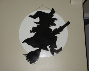 3D Witch flying past the moon wall hanging.