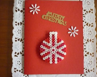 A ball of red and White Christmas card, send those wishes.
