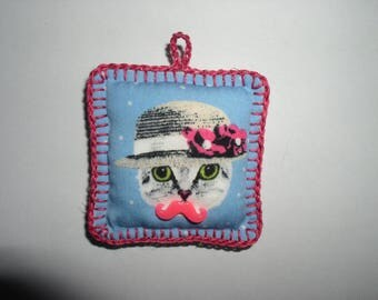 small cat cushion with hanging fabric and crochet Hat