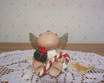 Angel Cheeks Figurine with Candy Cane and Present