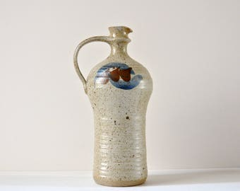 Studio pottery jug / vase. An unusual and unique shape and very well made.