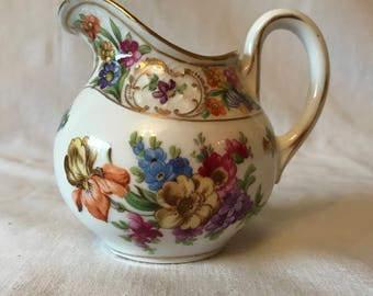 Antique Bavaria Cream Pitcher Schuman Floral pattern trimmed in gold bright vivid colors orange blue yellow pink