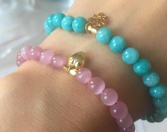 Aquamarine Semi Precious Stone Stretch Bracelet with Gold Lotus Charm