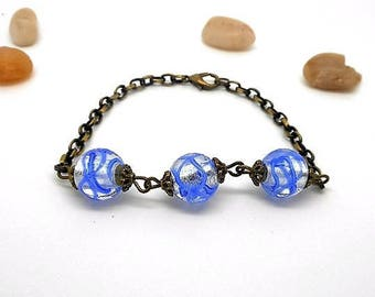 Bronze pearl bracelet white with blue border