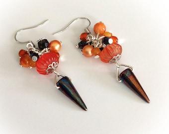 Earrings, long, Orange, blue iridescent, flowering.