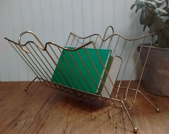 Brass color magazine rack, mid century magazine rack