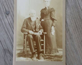 Victorian era older couple in mourning cabinet card