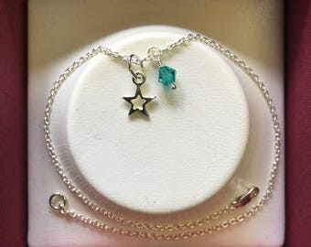 Sterling silver anklet with star charm and blue Swarovski crystal