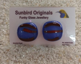 Blue glass stud earrings with fun red highlights