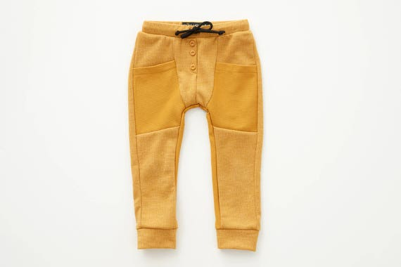 SAUGE - jogging pant, skinny fit for kids: boys and girls - mustard yellow