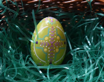 Hand painted wooden egg spring green with cross. dots and design