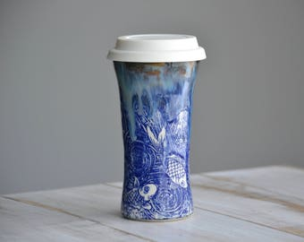 Tall handmade pottery travel mug blue fish and drippy glazes silicon lid