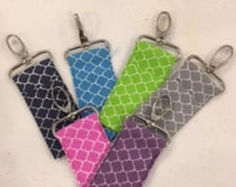 Key fobs, chapstick holders, bag tag for chapstick