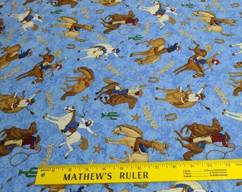 Rodeo Roundup-Horses on Blue Cotton Fabric from Northcott Studios