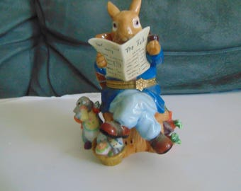 Father Rabbit reading  his paper with little bunny drinking his bottle trinket box