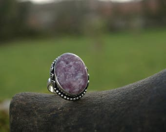 Lepidolite T 54 or US 7 ring, helps emotional wounds.