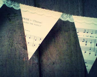Pretty vintage sheet music and lace bunting. Eco-friendly decor <3 Pretty garland.