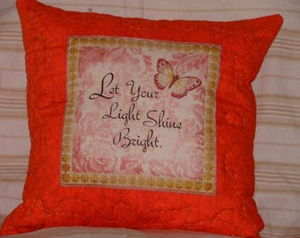 Orange pillow with inspirational quote