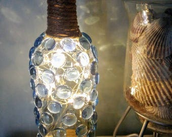 Upcycled Wine bottle with Light Blue Stones that lights up with Micro LED lights