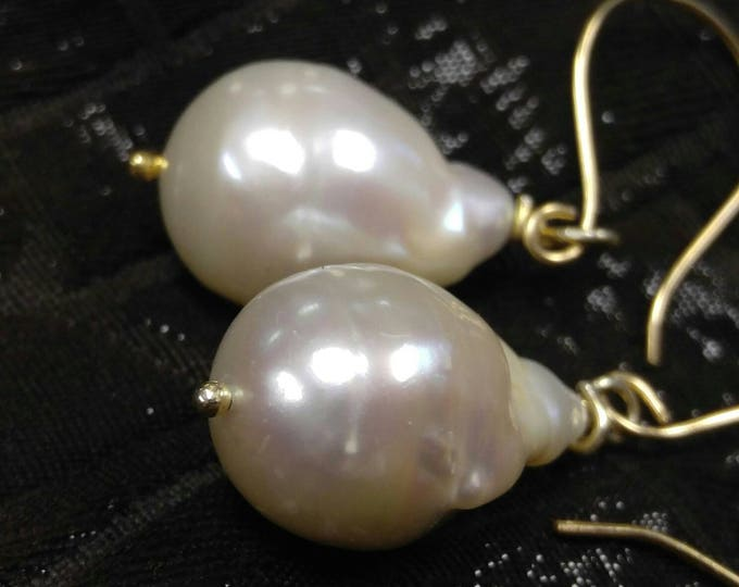 Large Cream Baroque pearl earrings, wrapped in 14k gold. Lusterous cream pearls. Natural organic large pearls. 14k yellow gold. Hand-made