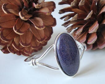Silver Plated Blue Goldstone Gemstone Knot Bangle