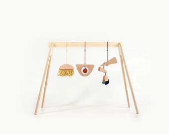 Wooden baby play gym with hanging toys