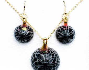 Blackhole Amulet and Earrings