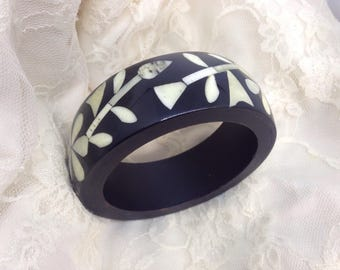 Black wooden bangle inlaid with flowers