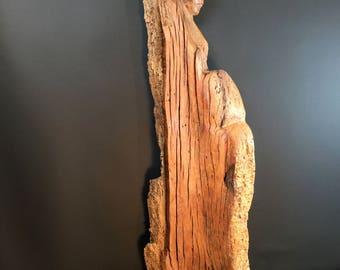Warrior and Child. wood sculpture.