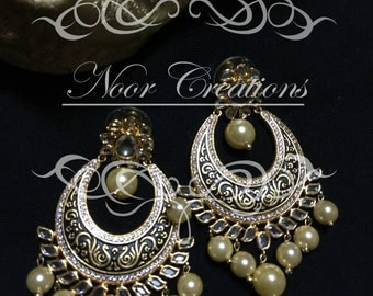 Intricate Black on Gold Detailing with Stunning Pearl Work