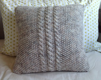 Hand knitted oatmeal fleck cable and moss stitch Aran cushion cover