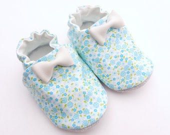 Baby booties leather sole and blue cotton floral with a leather bow