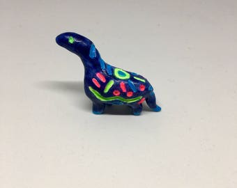 Glow in the dark dinosaur figurine