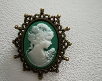 Metal with green and white cameo brooch