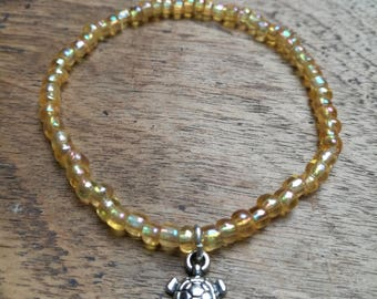 Yellow seed bead and silver turtle charm, stretchy bracelet, wish bracelet