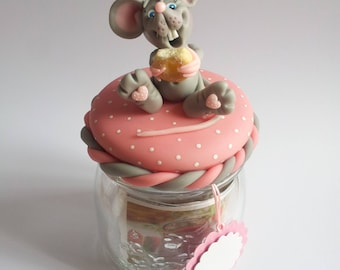 Jar decorated with a little mouse