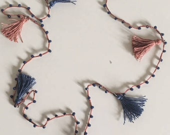 Ancient pink cotton long necklace with blue colored jeans and cotton nappins