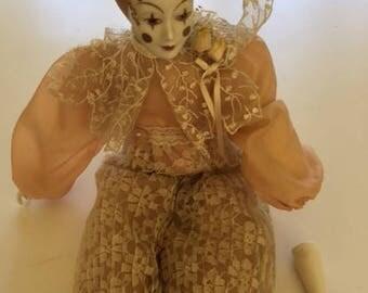 Vintage porcelain Harlequin doll in pink lace
