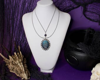 Adrastea gothic necklace, Gothic cameo necklace with skeleton hand, Blue and purple base with silver chains, Gift for her, Gothic fantasy
